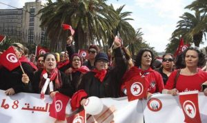 tunisia_women_wave_flags_during_a_march_to_celebrate_international_womens_day_in_tunis_on_march_8_2014